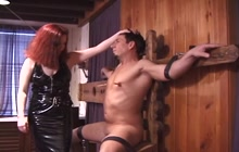 Dominant redhead plays with a dude's dick