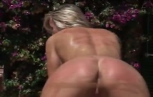 Blondie takes brutal ass whipping outdoors