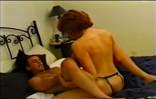 Dude gets strapon fucked by brunette chick