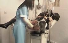 Patient gets enema by German nurse in latex