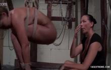 Mistress abusing her slaves