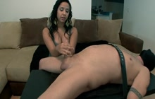 Dominant brunette gives intense handjob