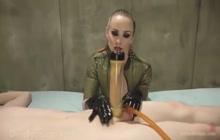 Rubber Dominatrix Milking Her Slave