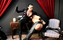 Kinky domina in Latex and her horny slave
