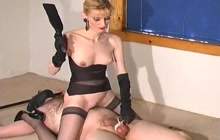Blonde slut spanking slave's balls