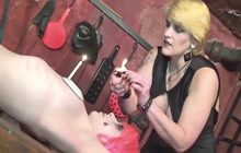 Mature blonde dominates and humiliates slave