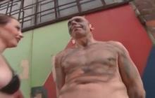 Kinky slut dominates bald guy outside